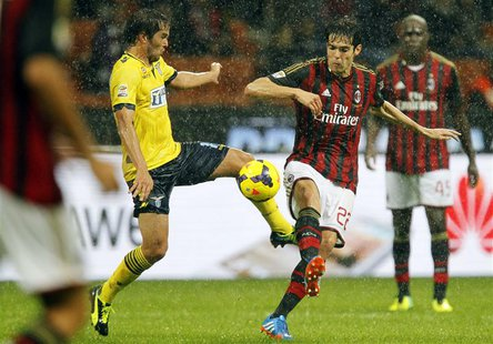 AC Milan's Kaka (R) fights for the ball with Lazio's Alvaro Gonzalez during their Italian Serie A soccer match at San Siro stadium in Milan