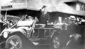 "President Teddy Roosevelt riding in the ""Flyer"" automobile made in Sioux Falls, SD"