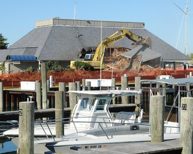 Cranes work on demolishing the 49-year-old Macatawa Bay Yacht Club clubhouse. (photo courtesy Macatawa Bay Yacht Club)