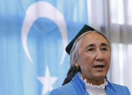 Uighur leader Rebiya Kadeer delivers a speech in front of a East Turkestan flag at the fourth General Assembly of the World Uighur Congress