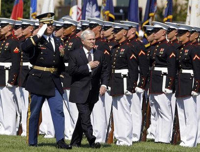 Retiring U.S. Defense Secretary Robert Gates inspects a military honour guard during his farewell ceremony at the Pentagon near Washington,