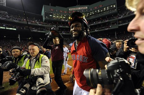 Oct 30, 2013; Boston, MA, USA; Boston Red Sox designated hitter David Ortiz celebrates on the field after game six of the MLB baseball World
