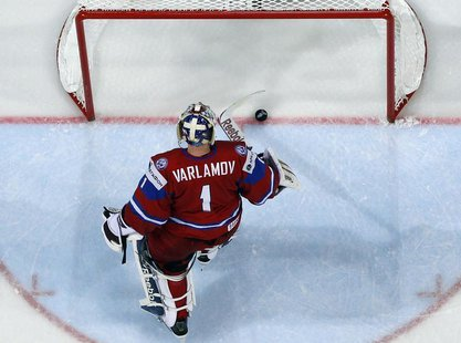 Russia's goalie Semyon Varlamov reacts after conceeding a goal to Finland during their 2013 IIHF Ice Hockey World Championship preliminary r