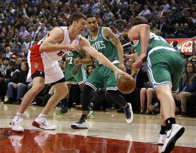 Oct 30, 2013; Toronto, Ontario, CAN; Toronto Raptors forward Tyler Hansbrough (50) tries to take the ball away from Boston Celtics forward K