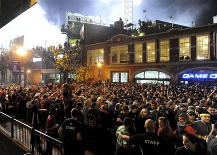 Fans gather after the Boston Red Sox won the MLB baseball's World Series by beating St. Louis Cardinals in Game 6, at Landsdown Street near
