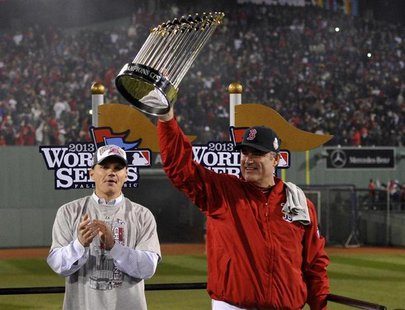 Oct 30, 2013; Boston, MA, USA; Boston Red Sox manager John Farrell hoists the World Series championship trophy after game six of the MLB bas