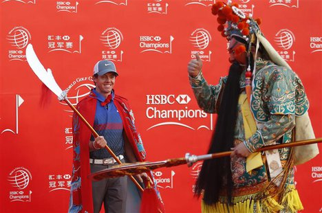 Golfer Rory McIlroy of Northern Ireland attends a photo call for the WGC-HSBC Champions golf tournament on the Bund in Shanghai October 29,