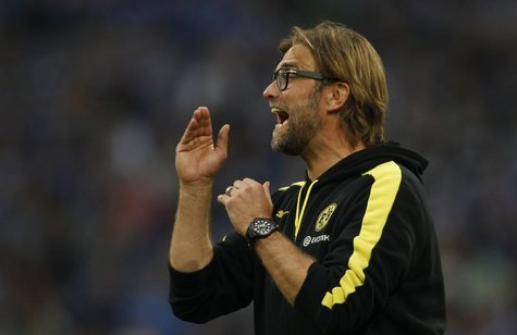 Borussia Dortmund's coach Juergen Klopp reacts during the German first division Bundesliga soccer match against Schalke 04 in Gelsenkirchen