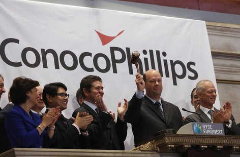 ConocoPhillips Chairman and Chief Executive Officer Ryan M. Lance (2nd R) rings the closing bell at the New York Stock Exchange (NYSE), Febr