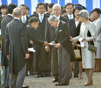 Japanese lawmaker Taro Yamamoto (3rd L) hands a letter to Emperor Akihito (front C), while Empress Michiko (R) looks on, during the annual a