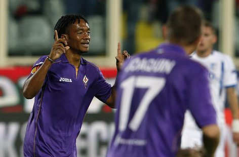 Fiorentina's Juan Cuadrado celebrates after scoring against Pandurii Targu-Jiu during their Europa League soccer match at the Artemio Franch