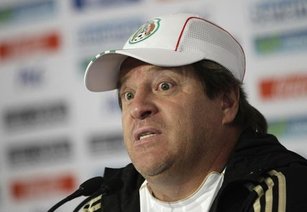 Mexico's national soccer team coach Miguel Herrera listens to a journalist's question during a news conference after a friendly match agains