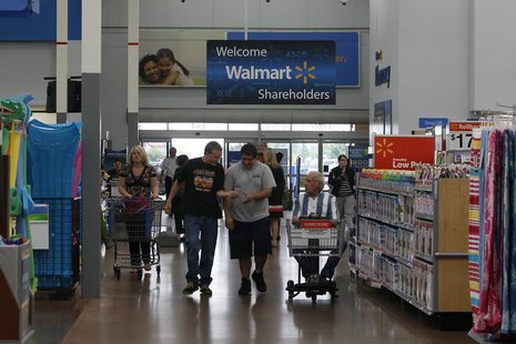 Customers shop at a Walmart Supercenter in Rogers, Arkansas June 6, 2013. REUTERS/Rick Wilking