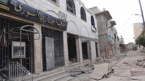 A view of a destroyed Syrian Commercial Bank branch after clashes between the Free Syrian Army and forces loyal to Syria's President Bashar