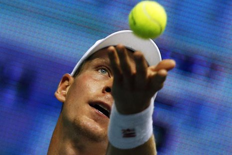 Tomas Berdych of the Czech Republic serves against Gilles Simon of France during their men's singles semi-finals match at the Thailand Open