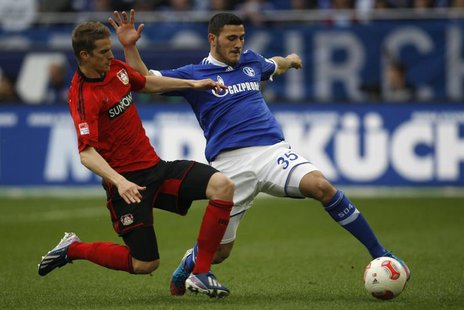 Bayer Leverkusen's Lars Bender tackles Schalke 04's Sead Kolasinac (R) during their German first division Bundesliga soccer match in Gelsenk