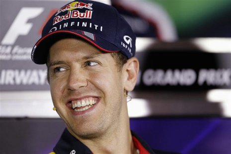 Red Bull Formula One driver Sebastian Vettel of Germany attends a news conference ahead of the Abu Dhabi F1 Grand Prix at the Yas Marina cir