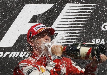 Ferrari GP Formula One driver Kimi Raikkonen of Finland drinks champagne on the podium after winning the Belgian F1 Grand Prix in Spa Franco