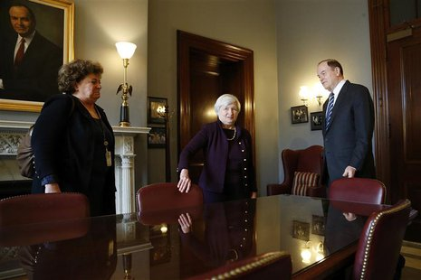 Janet Yellen (C), nominee to be the next chairman of the U.S. Federal Reserve, meets with Senate Banking Commitee member Senator Richard She