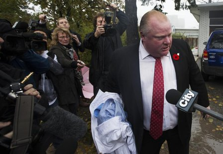 Toronto Mayor Rob Ford yells at reporters and photographers to get off of his property in front of his house in Toronto October 31, 2013. RE