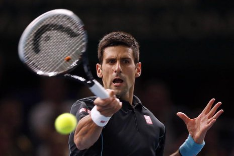 Novak Djokovic of Serbia hits a returns to Pierre-Hugues Herbert of France during their second round men's singles match at the Paris Master