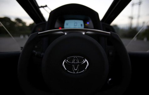 A logo of Toyota is seen on the steering wheel of Toyota's ultra-compact tandem two-seater electric vehicle i-ROAD during the Toyota Advance