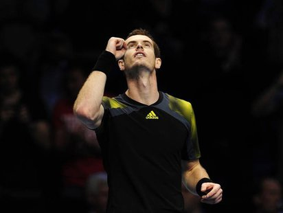 Andy Murray of Britain celebrates defeating Tomas Berdych of Czech Republic in their men's singles tennis match at the ATP World Tour Finals