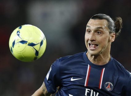 Paris Saint-Germain's Zlatan Ibrahimovic reacts as he eyes the ball during their French Ligue 1 soccer match against Valenciennes at the Par