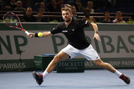 Stanislas Wawrinka of Switzerland prepares to return a shot to Nicolas Almagro of Spain at the Paris Masters men's singles tennis tournament