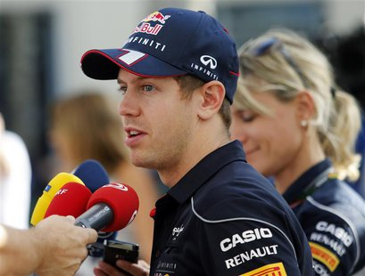 Red Bull Formula One driver Sebastian Vettel of Germany talks to the media ahead of the Abu Dhabi F1 Grand Prix at the Yas Marina circuit in
