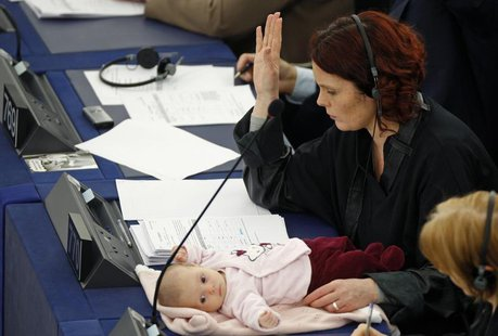 Denmark's member of the European Parliament Hanne Dahl votes as she attends with her baby a voting session at the European Parliament in Str