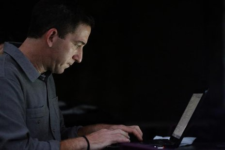 Glenn Greenwald, the blogger and journalist who broke the U.S. National Security Agency (NSA) surveillance scandal, uses his laptop after an