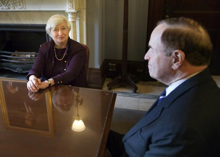 Janet Yellen (L), nominee to be the next chairperson of the U.S. Federal Reserve, sits down to a meeting with Senate Banking Committee membe