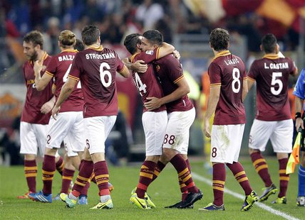 AS Roma's Marco Borriello (3rd R) celebrates with his team mates after scoring against Chievo Verona during their Italian Serie A soccer mat