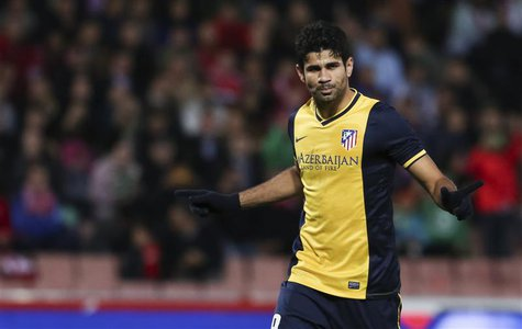 Atletico Madrid's Diego Costa celebrates after scoring against Granada during their Spanish First Division soccer match at Nuevo Los Carmene