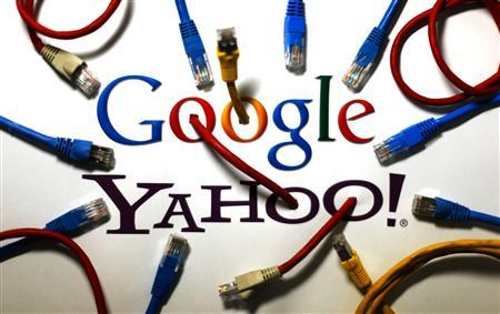 An illustration picture shows the logos of Google and Yahoo connected with LAN cables in a Berlin office October 31, 2013. Credit: Reuters/Pawel Kopczynski