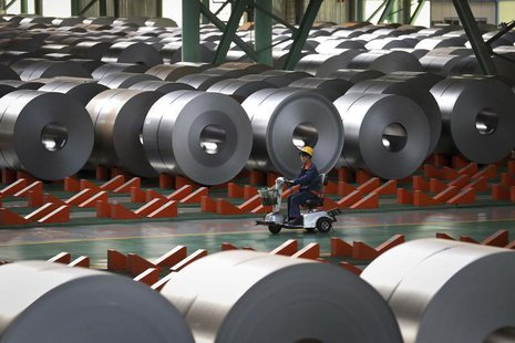 An employee works inside a steel factory in Caofeidian on the northeastern coast of China's Hebei province, October 11, 2013. REUTERS/China