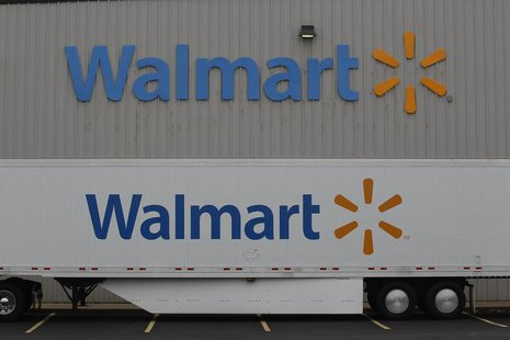 The Wal-Mart company logo is seen outside a Wal-Mart Stores Inc company distribution center in Bentonville, Arkansas June 6, 2013. REUTERS/R