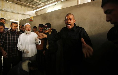 A Palestinian Hamas policeman reacts over the death of Hamas militant Rabee Baraka, at a hospital in Khan Younis in the southern Gaza Strip