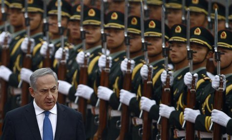 Israel's Prime Minister Benjamin Netanyahu (L) reviews the honour guards during an official welcoming ceremony at the Great Hall of the Peop