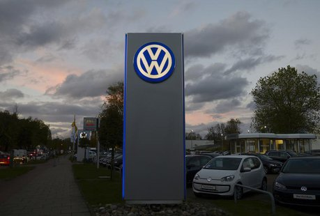 The logo of German carmaker Volkswagen is seen at a VW dealership in Hamburg, October 28, 2013. Volkswagen is due to present company results