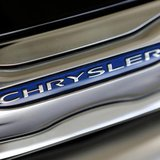 The Chrysler logo is shown on a new Chrysler 200 on the showroom at the Massey-Yardley Chrysler, Dodge, Jeep and Ram automobile dealership i