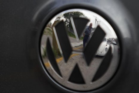 83-year-old Oscar Almaguer and his 1967 Volkswagen Beetle are reflected in the car insignia of another Volkswagen in Apodaca, on the outskir