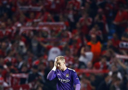 Manchester City's Joe Hart reacts during their Champions League soccer match against Bayern Munich at the Etihad Stadium in Manchester, nort
