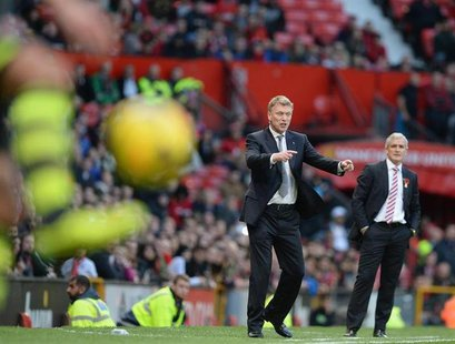 Manchester United's manager David Moyes gestures during their English Premier League soccer match against Stoke City at Old Trafford Stadium