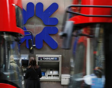 People stand near a branch of Royal Bank of Scotland (RBS) in London November 1, 2013. REUTERS/Luke MacGregor