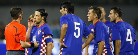 Croatia's captain Niko Kovac and teammates protest against referee Lubos Michel's decision to send Robert Kovac off during their World Cup 2