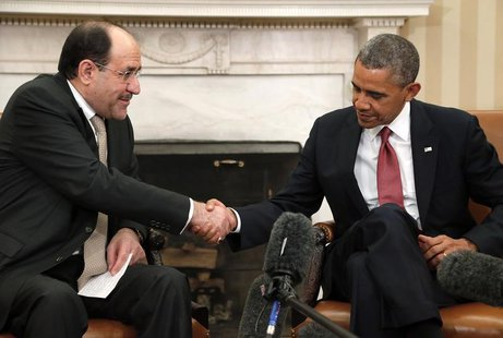 U.S. President Barack Obama (R) shakes hands with Iraq's Prime Minister Nuri al-Maliki (L) after their meeting in the Oval Office at the Whi