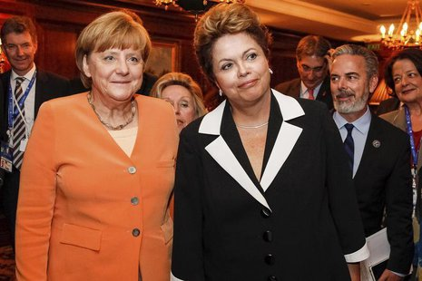 Brazil's President Dilma Rousseff (R) and German Chancellor Angela Merkel pose during a meeting at Santiago, in this photo provided by the B