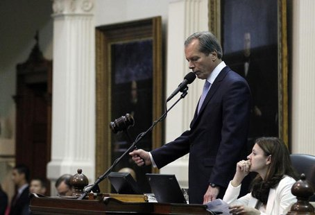 Texas Lieutenant Governor David Dewhurst strikes the gavel after the Senate passed legislation restricting abortion rights in Austin, Texas,